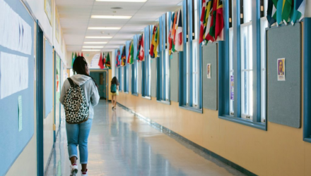 Image of a student in hallway.